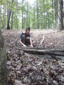 Me building a one-rock-high dam in a stream bed.